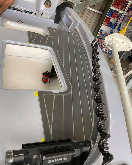 The Force F13 Fisher is having the Udek floor installed.  The final touches are coming together and we are looking forward to sharing the completed boat soon!