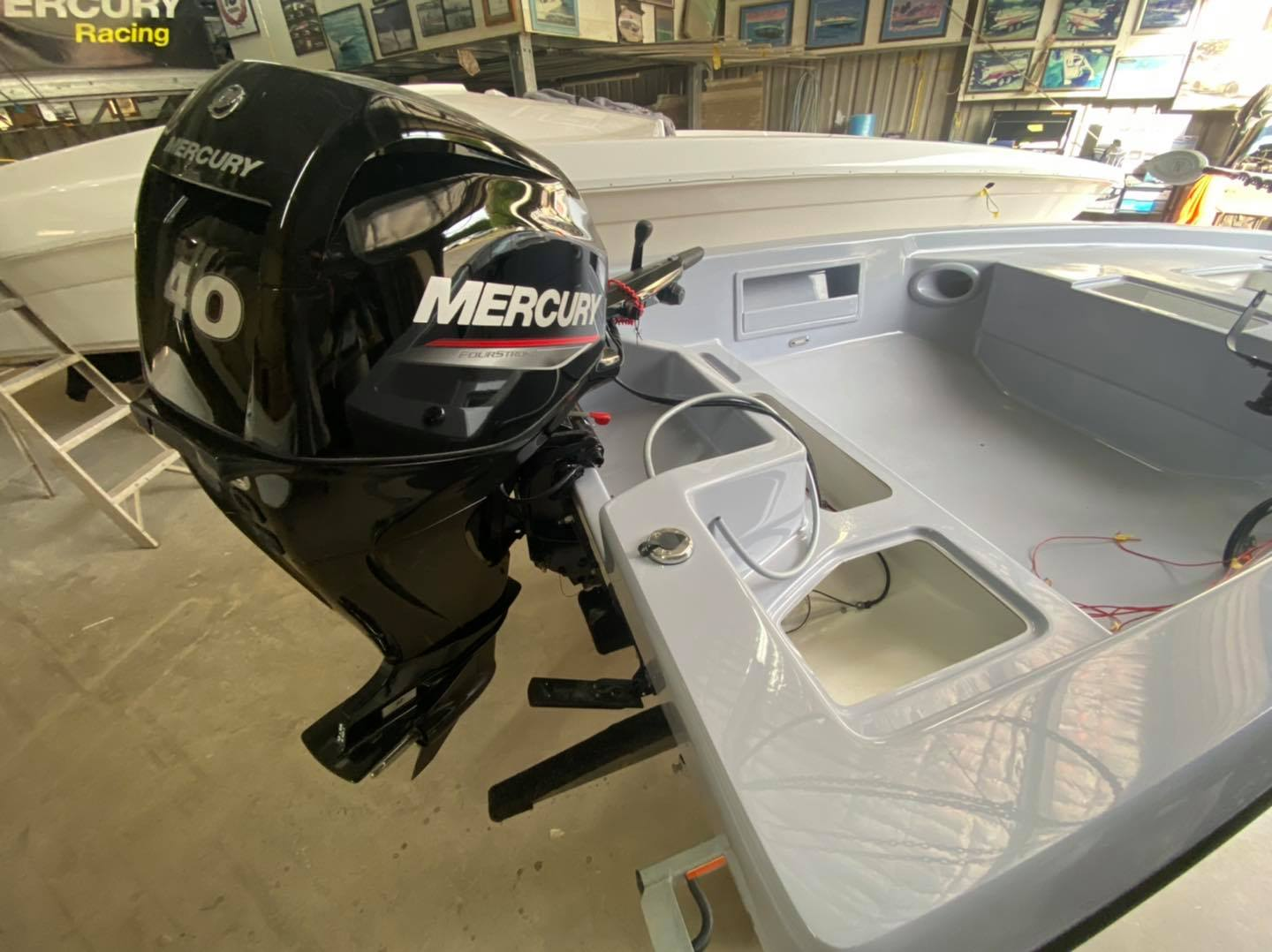 40hp, 4 stroke 3 cylinder electric start Mercury engine is installed!  The Force F13 Fisher is coming together nicely!